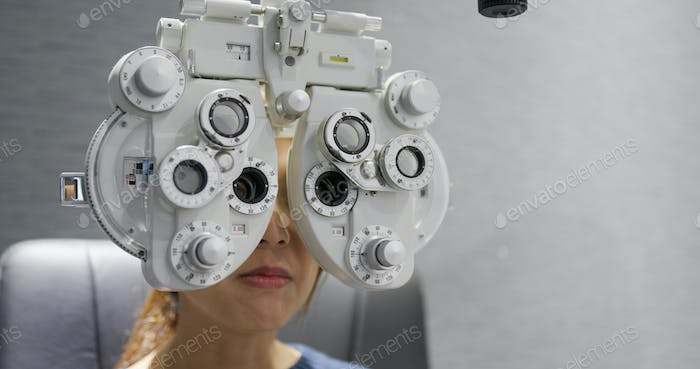 Woman check her eye at clinic