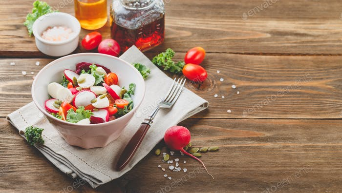 Salad with cherry tomatoes, radsh and mozzarella, lettuce mix