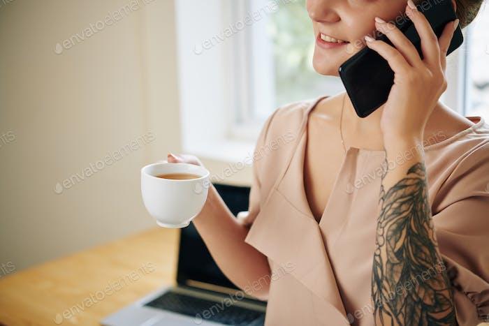 Positive woman talking on phone