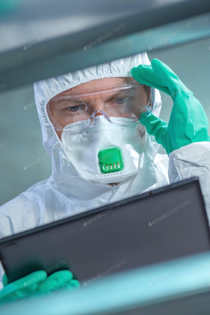 Virologist healthcare professional using tablet computer in laboratory