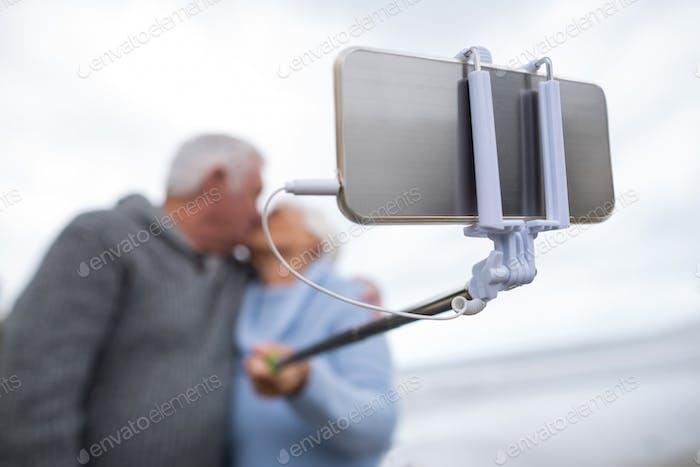 Senior couple taking a selfie from selfie stick