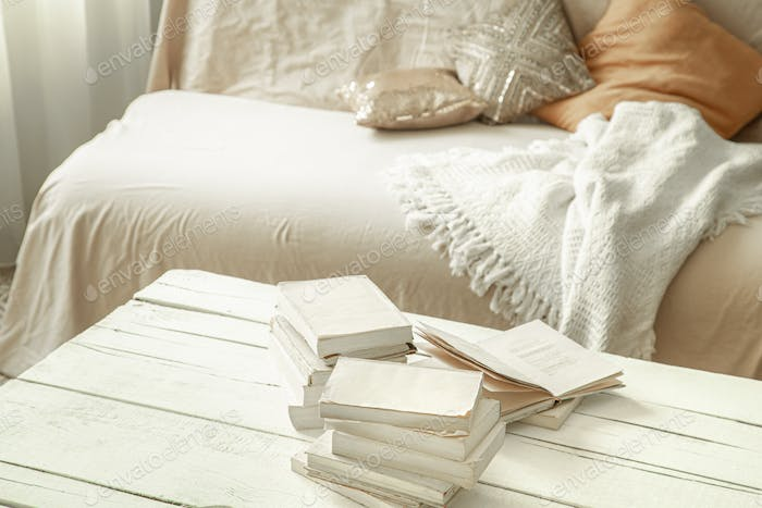 Cozy home atmosphere with books on the table.