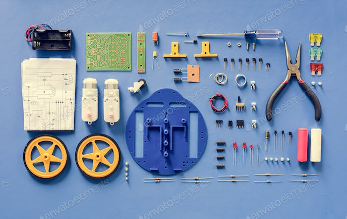Electronics tools equipments flat lay on blue background