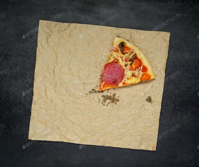 One Slice of Pizza on Dark Background