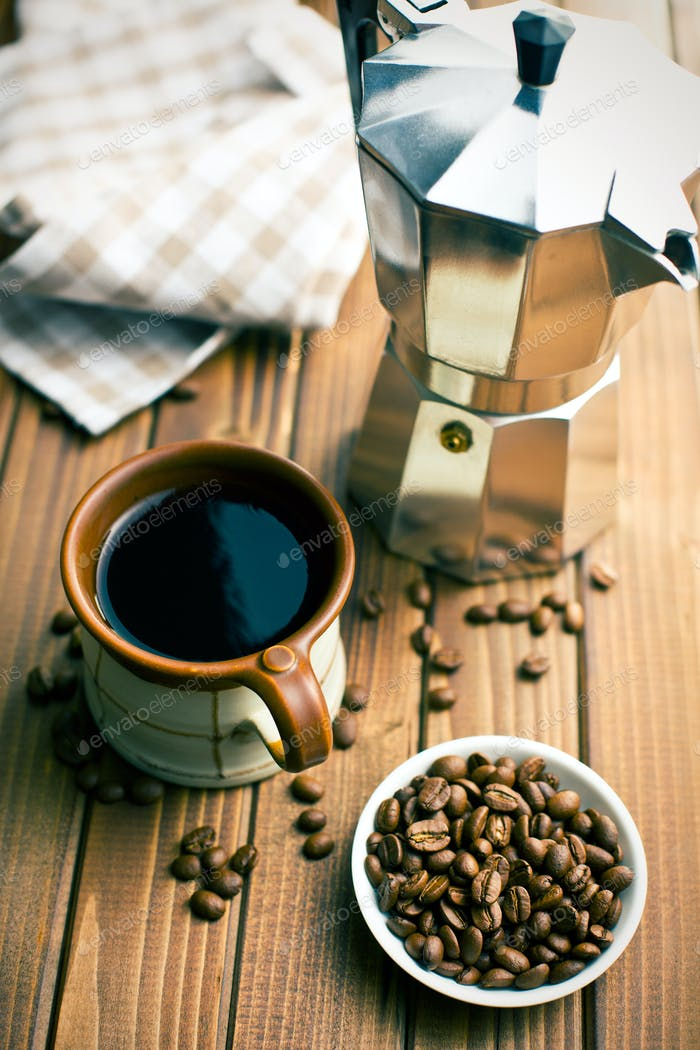 coffee with coffee beans and coffee maker
