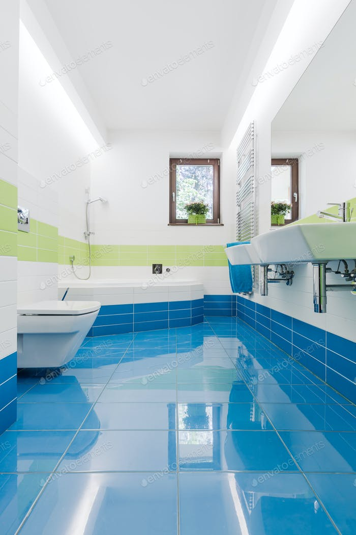Colorful bathroom with toilet and sinks