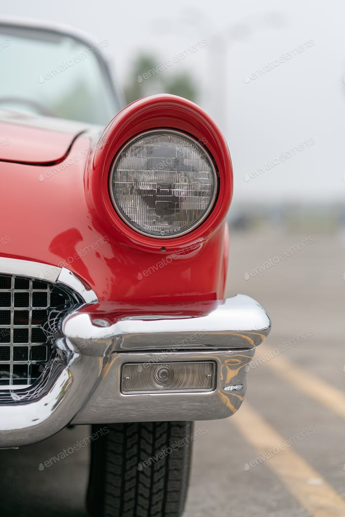 Close up of vintage red car bumber and lamps