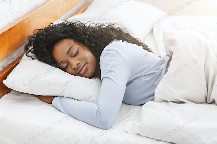 Beautiful girl sleeping in bed in morning