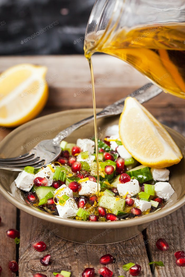 Fresh healthy green salad with pomegranate