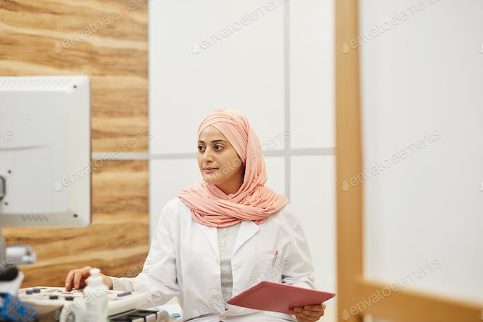 Middle-Eastern Nurse Working in Clinic