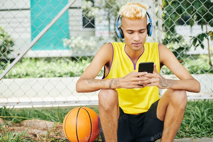 Basketball player listening to music