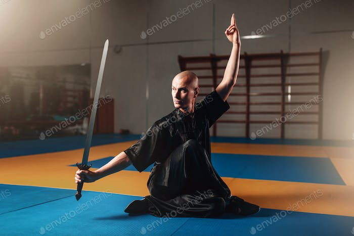 Wushu master training with sword, martial arts
