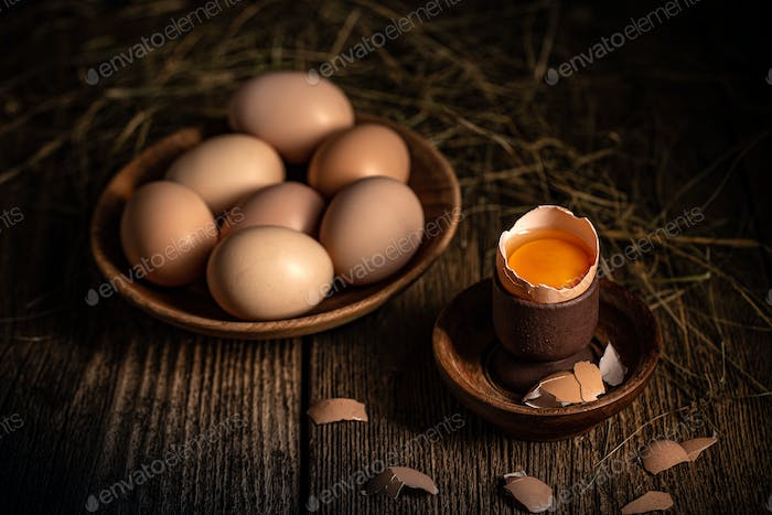 Whole and broken raw brown eggs