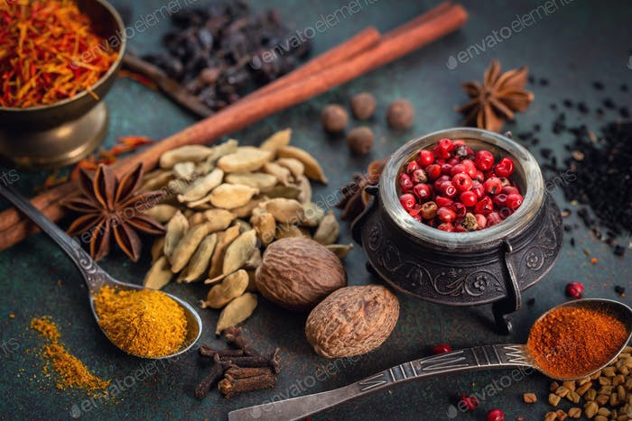 Various spices on dark