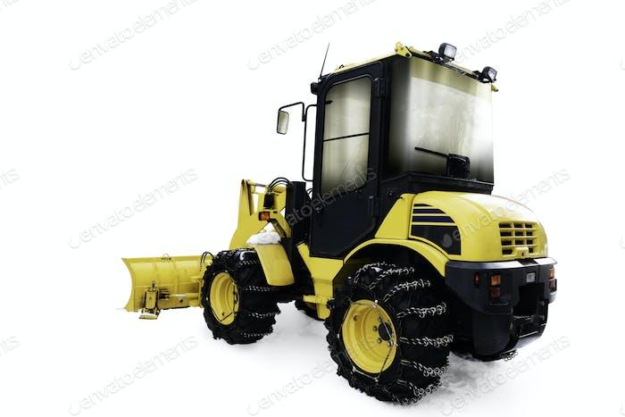 Yellow bulldozer in pile of snow