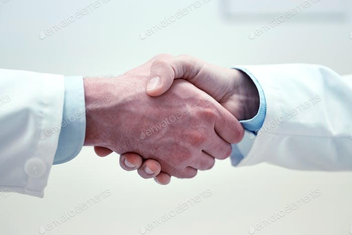 close up of doctors hands making handshake