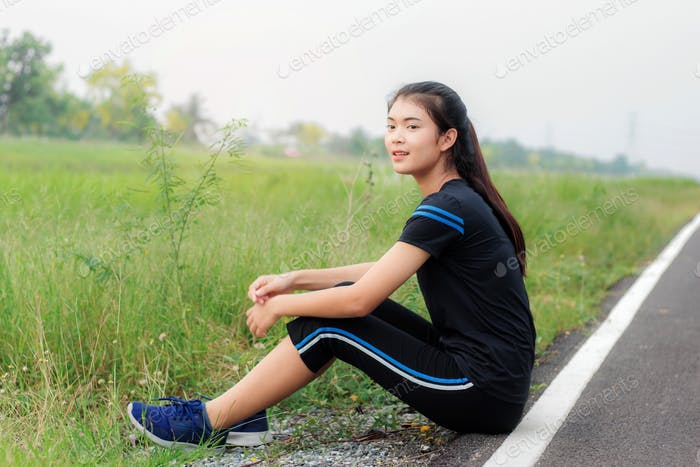 Girl is sitting on road