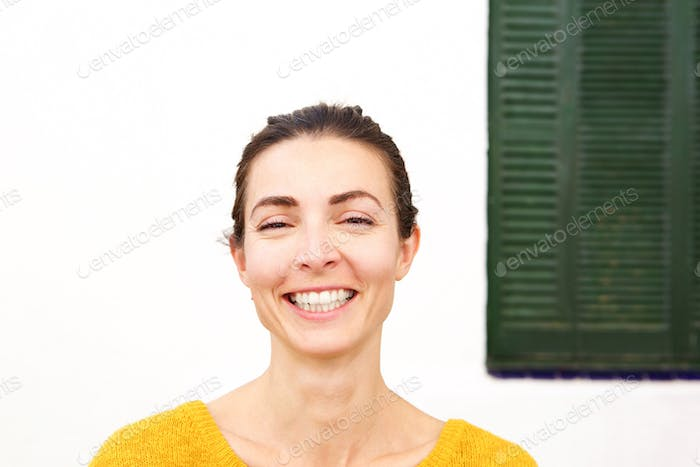 Close up young woman smiling happily