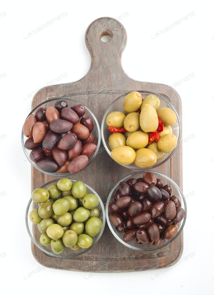 overhead make several bowls of homemade olive oil on white background