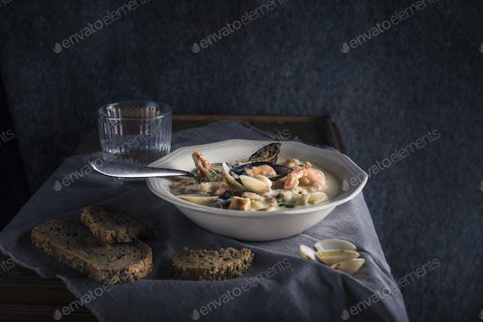 Clam chowder in a white plate