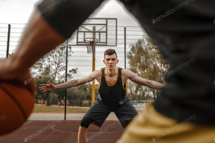 Basketball players, outdoor court, active leisure