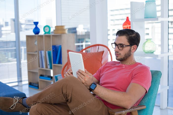 Male executive using digital tablet in the office