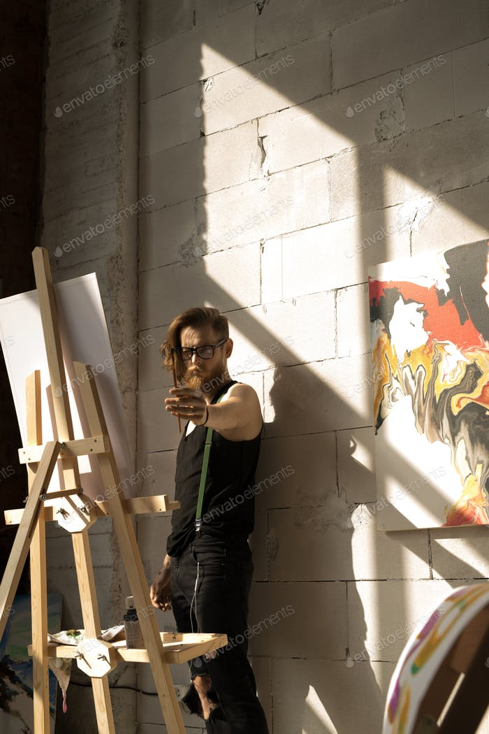 Inspired Artist Painting in Sunlight
