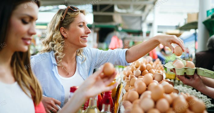 Beautiful happy women shopping vegetables and fruits