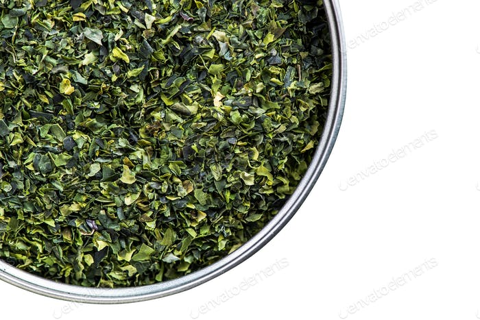 Aonori seaweed flakes in pot,isolated on white