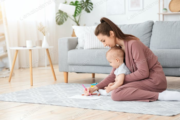 Early Development For Babies. Mother Drawing With Her Little Son At Home