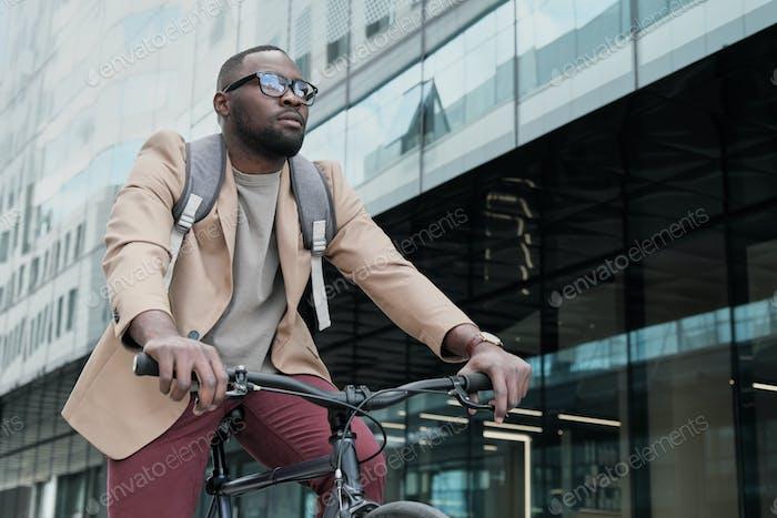 Businessman riding on a bike