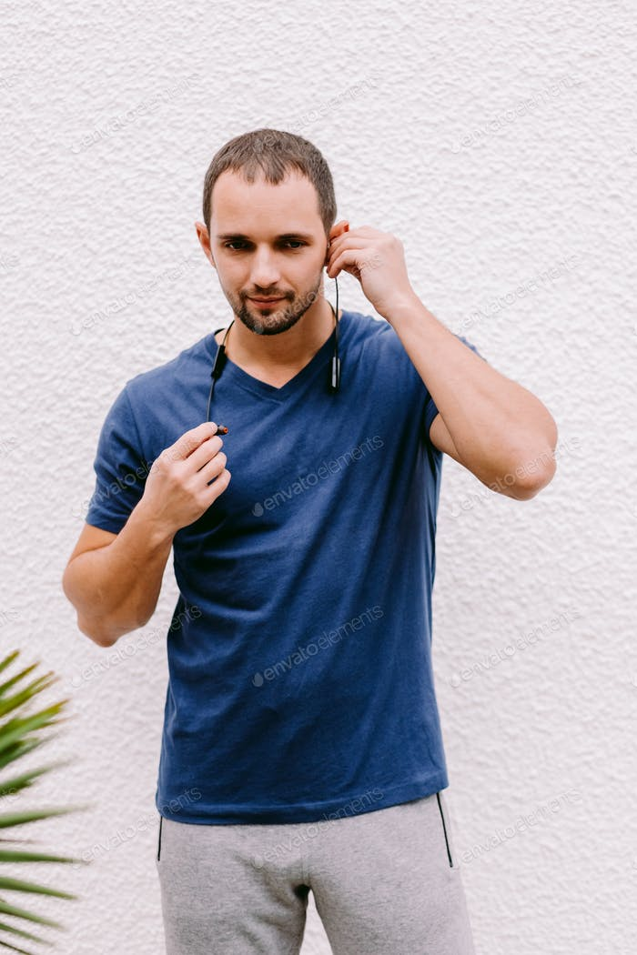 Placeit man in blue t-shirt mockup wearing sunglasses and listen music