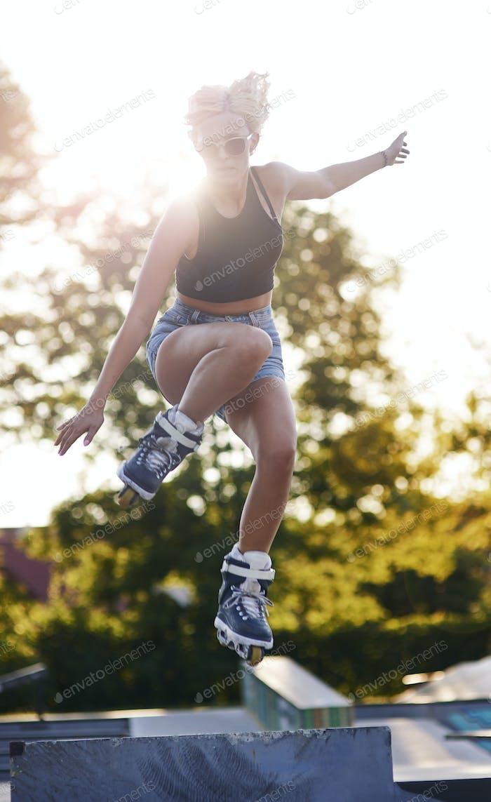 High jump on rollerblades in the skatepark