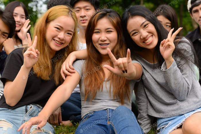 Thumbnail for Happy young group of friends having fun together at the park