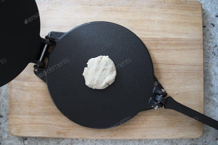 Dough on Tortilla Press