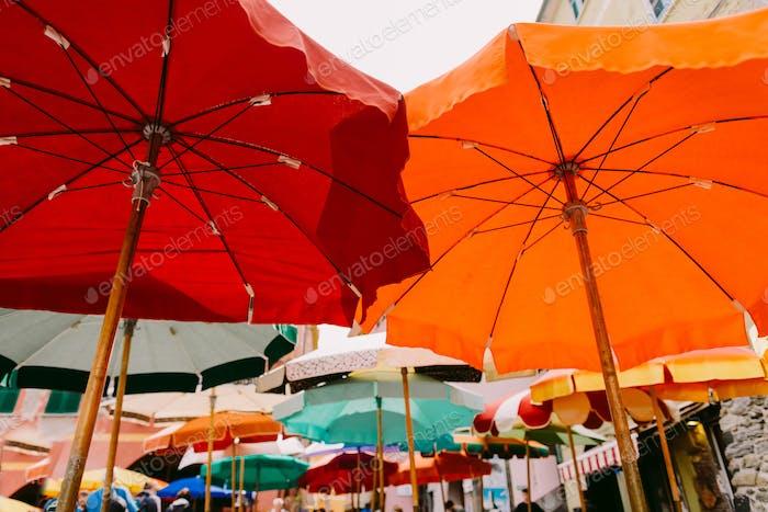 colourful umbrellas street in italy