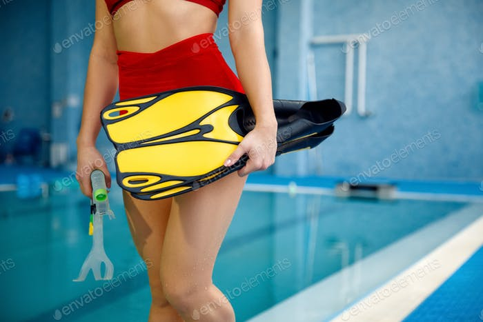 Female swimmer with mask and snorkel for diving