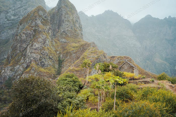 Santo Antao Cape Verde. Ruined local storehouse nestled into incredible scenery with steep mountain