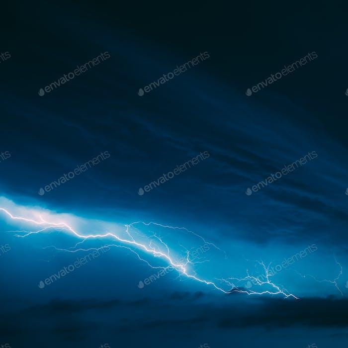 Bright Lightning On Blue Night Sky During Thunderstorm
