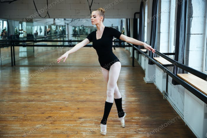 Attractive ballerina dancing