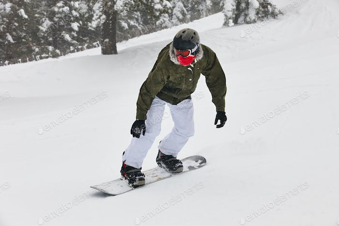Snowboarding on a snow forest landscape. Winter sport. Horizontal