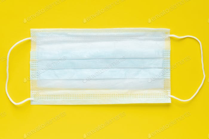 Medicine Surgical Face Mask on Yellow Background