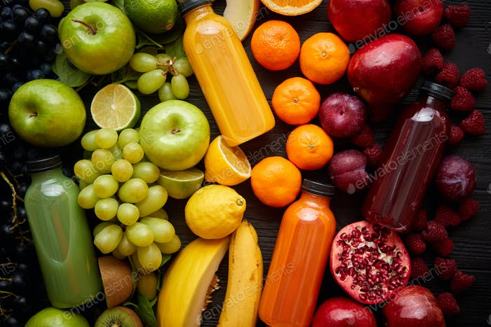 Healthy food concept. Various mixed fruits, vegetables and juices formed in rainbow