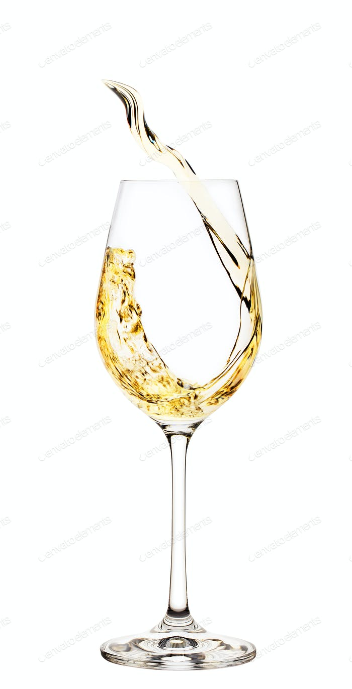 Spritzer von Weißwein im Glas