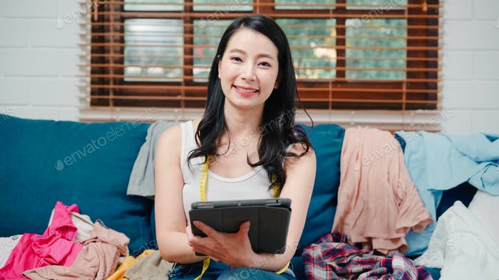 Portrait of Asian stylist fashion influencer designer women owner of online business.