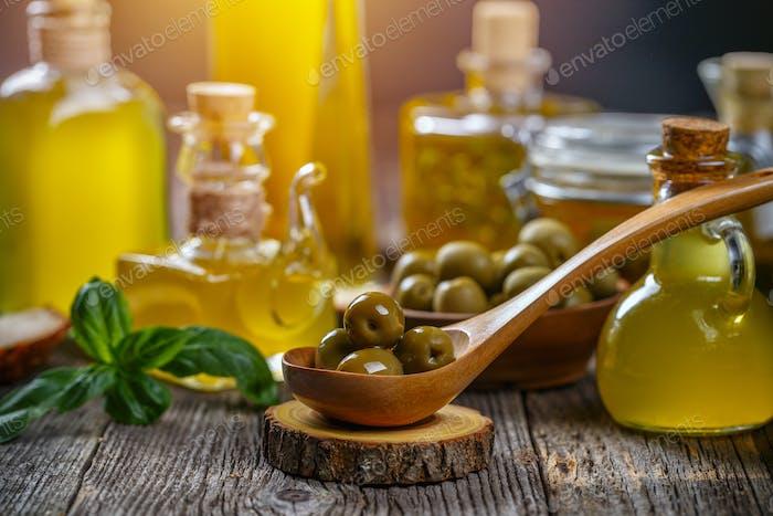 Olives and bottles of extra virgin olive oil