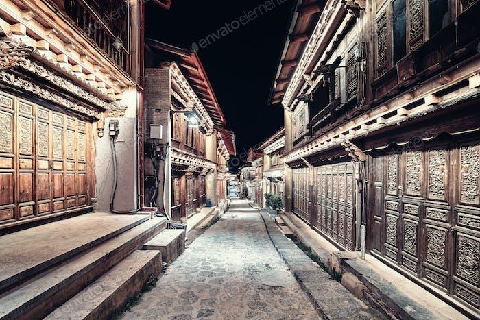 Illuminated empty street of Shangri La at night, China.