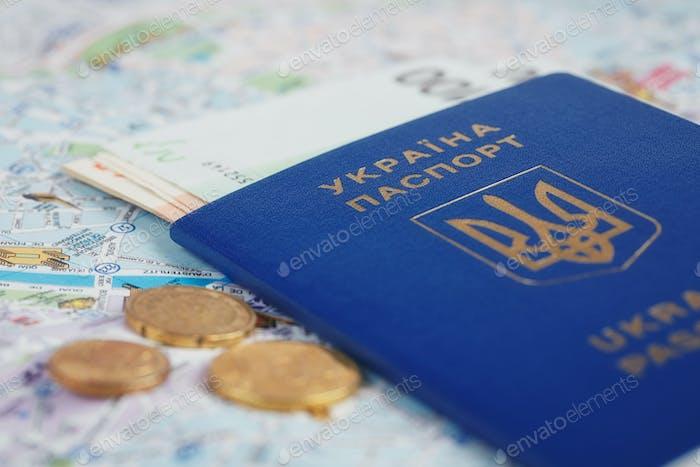 Ukrainian passport and money on map