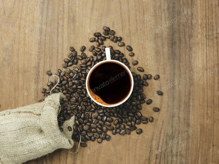 top view black coffee and coffee bag with wood background