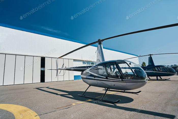 Two choppers on landing pad at vertiport